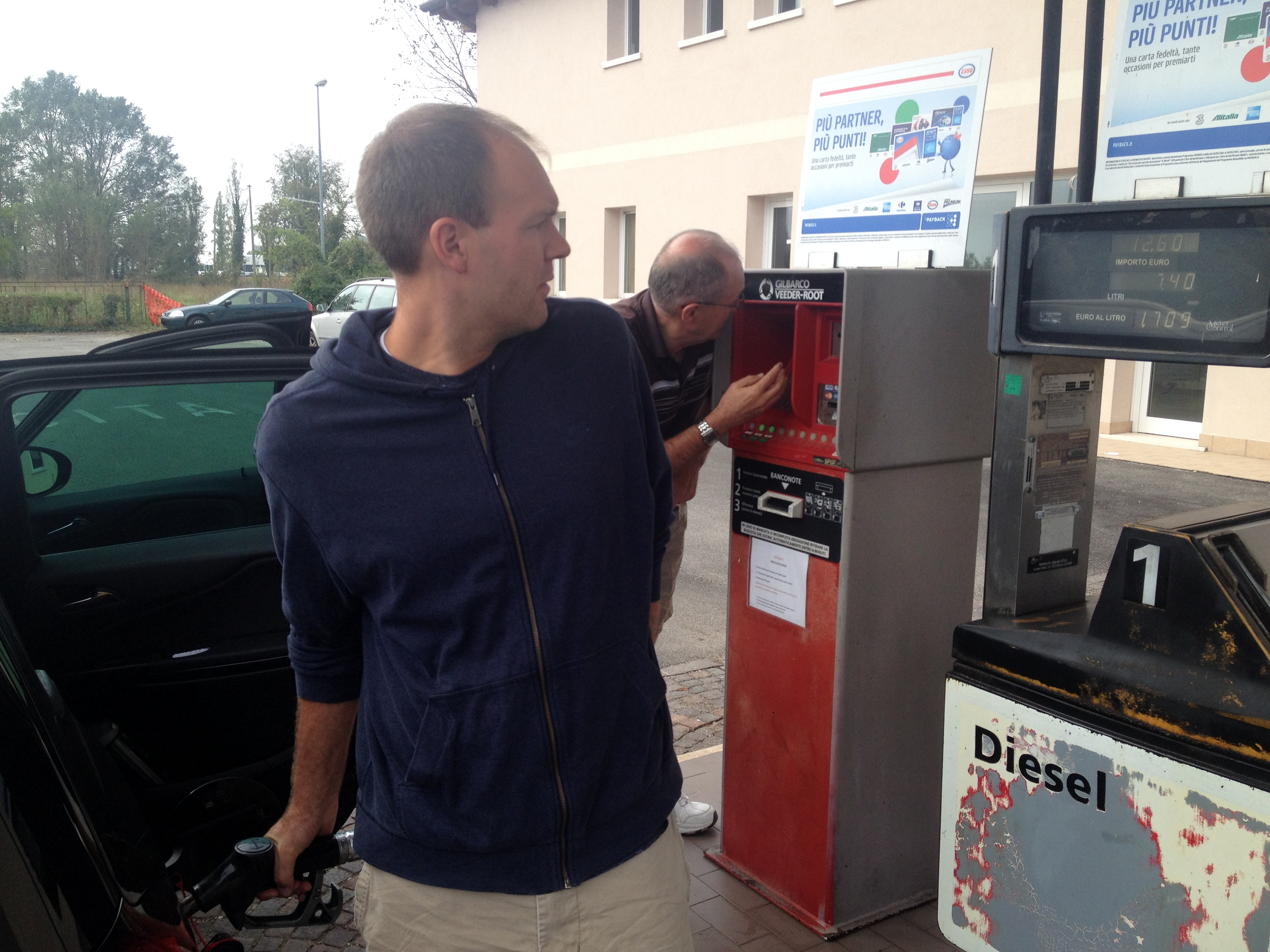 Trying to figure out how to work the European gas pump. Like many European vehicles, it was a stick shift and used diesel fuel.